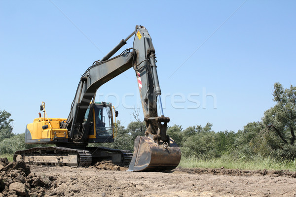 Stock photo: excavator on road construction