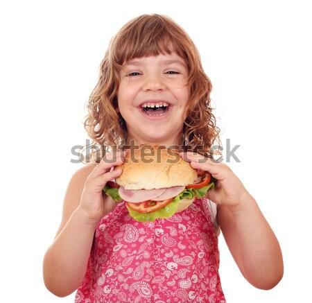 happy little girl holding big sandwich Stock photo © goce