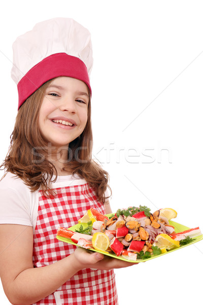 happy little girl cook with seafood on plate Stock photo © goce
