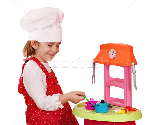 happy little girl play cooking Stock photo © goce
