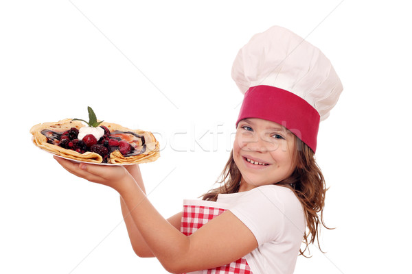 happy little girl cook with crepes Stock photo © goce