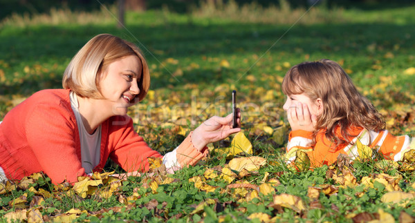 mother with smartphone take picture of daughter Stock photo © goce