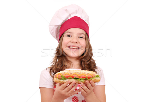 happy little girl cook with hot dog Stock photo © goce
