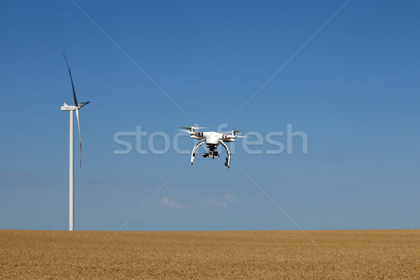 drone flying over wheat field with wind turbine Stock photo © goce