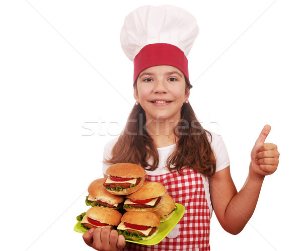 happy little girl cook with hamburgers and thumb up Stock photo © goce