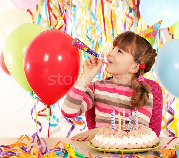 Mutlu küçük kız trompet doğum günü pastası gülümseme çocuklar Stok fotoğraf © goce