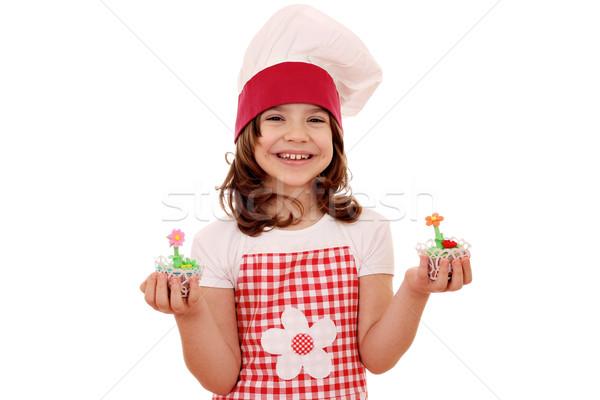 Boldog kislány szakács tart édes muffin Stock fotó © goce