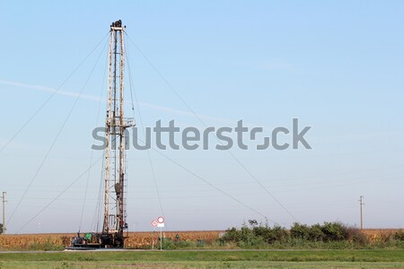 oilfield with oil drilling rig Stock photo © goce