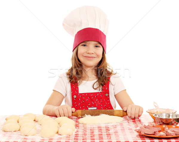 little girl kneading dough with rolling pin Stock photo © goce