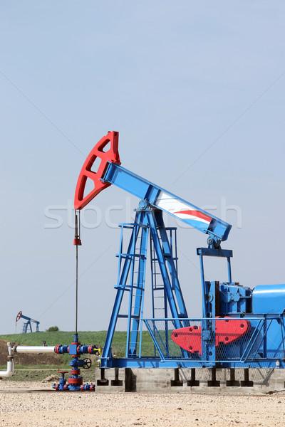 two oil pump jack on oilfield Stock photo © goce