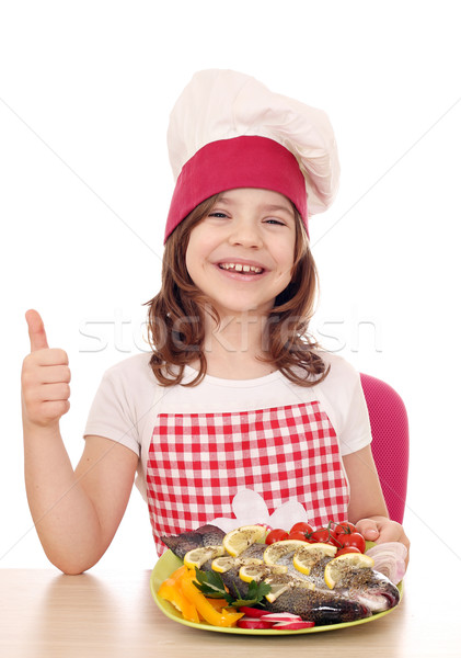 happy little girl cook with trout and thumb up Stock photo © goce