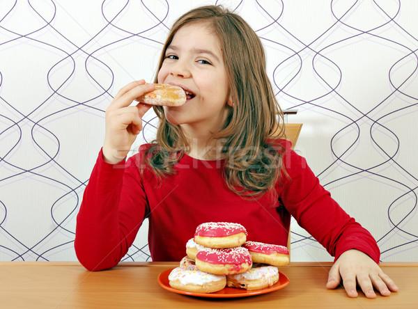 Głodny dziewczynka jeść słodkie dziewczyna Zdjęcia stock © goce
