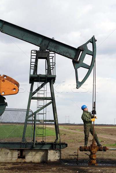 oil worker check pumpjack Stock photo © goce