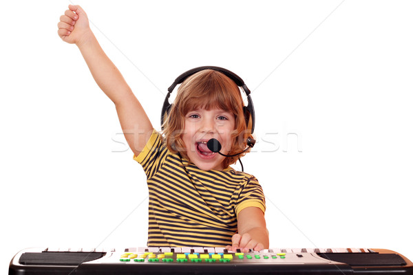 little girl play keyboard and sing Stock photo © goce