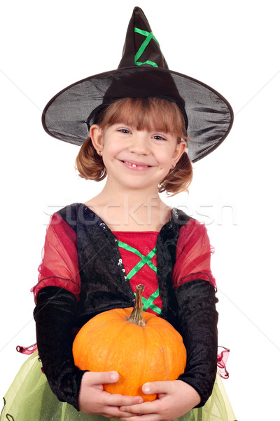 happy little girl witch with pumpkin halloween Stock photo © goce