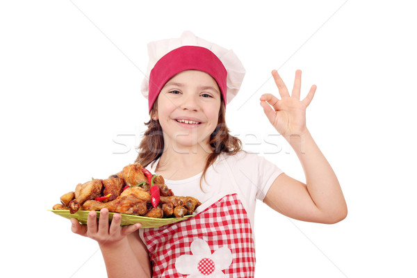 happy little girl with chicken drumstick and ok hand sign Stock photo © goce