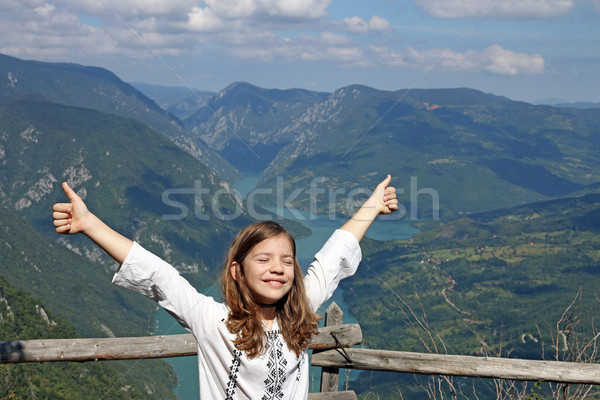 happy little girl with thumbs up on mountain Stock photo © goce