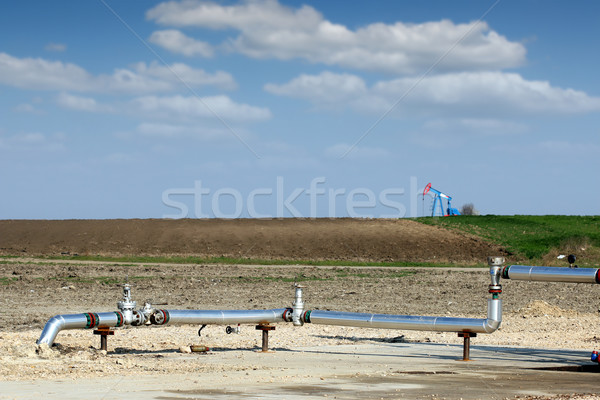 oil pump jack and pipeline on oilfield Stock photo © goce