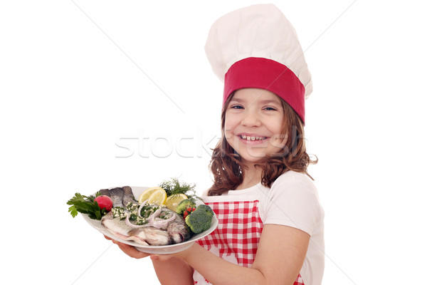 Szczęśliwy dziewczynka gotować pstrąg ryb dziewczyna Zdjęcia stock © goce