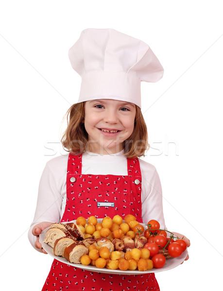 Mutlu küçük kız pişirmek plaka gurme gıda Stok fotoğraf © goce