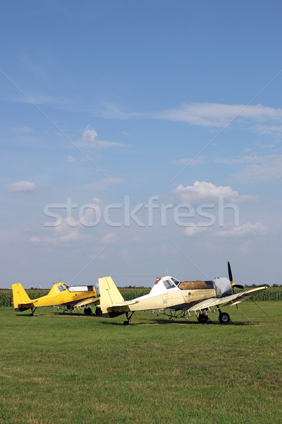 two crop duster airplanes on airfield Stock photo © goce