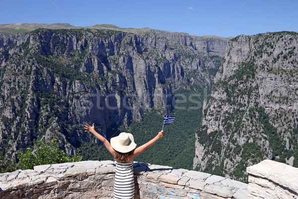 little girl waves with a Greek flag on Vikos gorge Zagoria Stock photo © goce