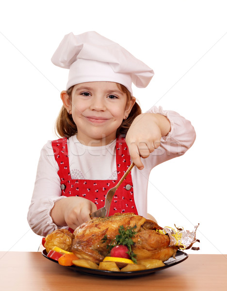 little girl cook cutting roast chicken Stock photo © goce
