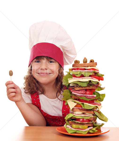 happy little girl with olive and tall sandwich Stock photo © goce
