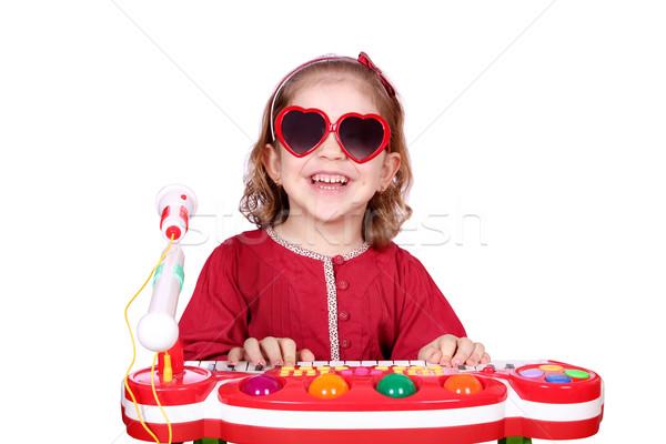 Boldog kislány napszemüveg játék zene mosoly Stock fotó © goce