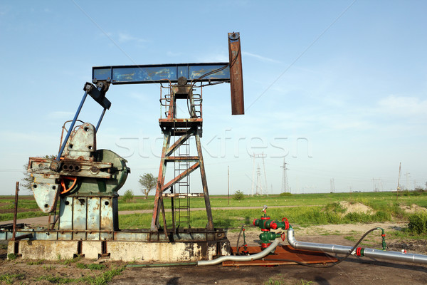 oilfield with pump jack and pipeline Stock photo © goce