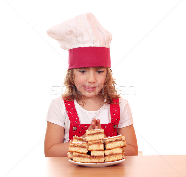 hungry little girl cook looking at apple cakes Stock photo © goce