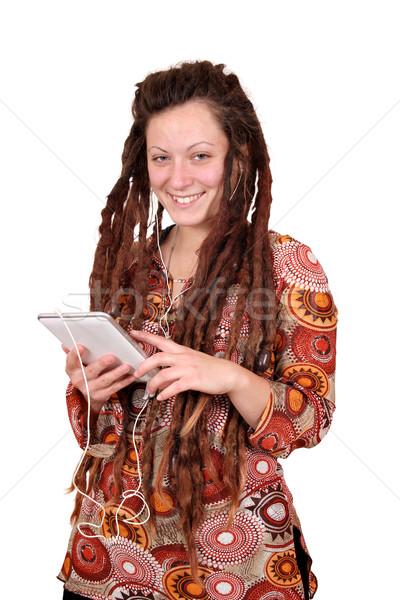 happy girl with dreadlocks hair listening music on tablet Stock photo © goce