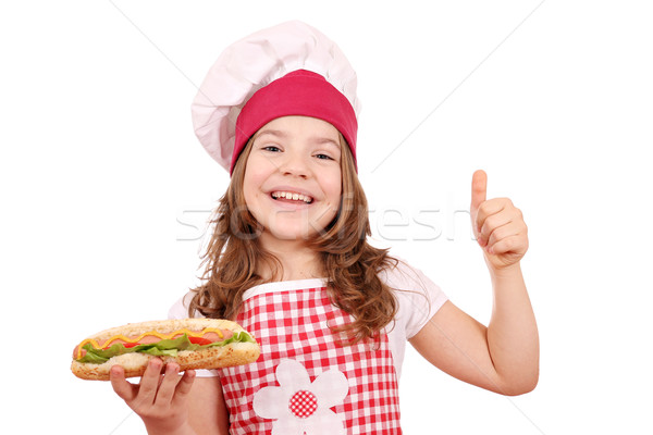 happy little girl with hot dog and thumb up Stock photo © goce