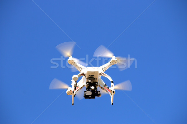Drone flying in the blue sky Stock photo © goce