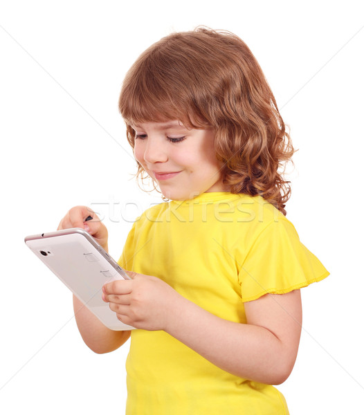 happy little girl playing with tablet Stock photo © goce