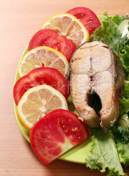 Frutti di mare salmone limone pomodori insalata verdura Foto d'archivio © goce