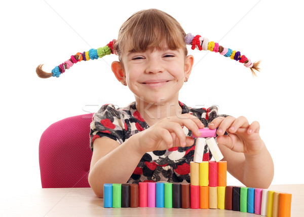 happy little girl play with colorful plasticine Stock photo © goce