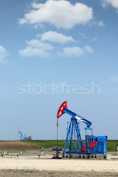 oil pump jack on field industry Stock photo © goce