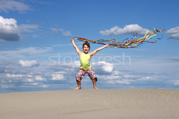 happy little girl on windy beach Stock photo © goce