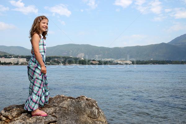 happy little girl standing on rock near sea Corfu island Stock photo © goce