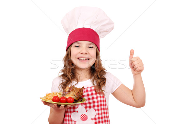 happy little girl cook with chicken wings and thumb up Stock photo © goce