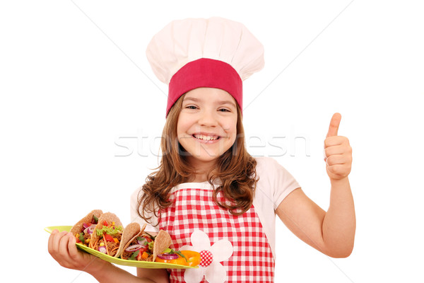 happy little girl cook with tacos and thumb up Stock photo © goce