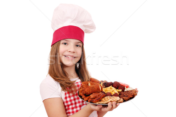 Meisje kok gegrild vlees plaat gelukkig kind Stockfoto © goce