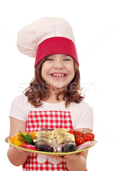 happy little girl cook with trout fish on plate  Stock photo © goce