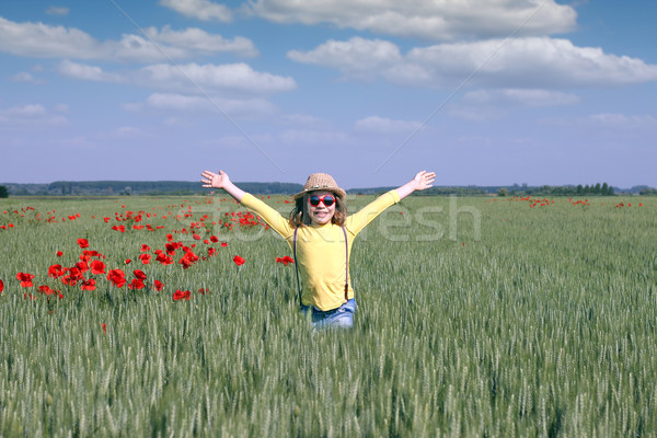 little girl on green wheat field spring season Stock photo © goce