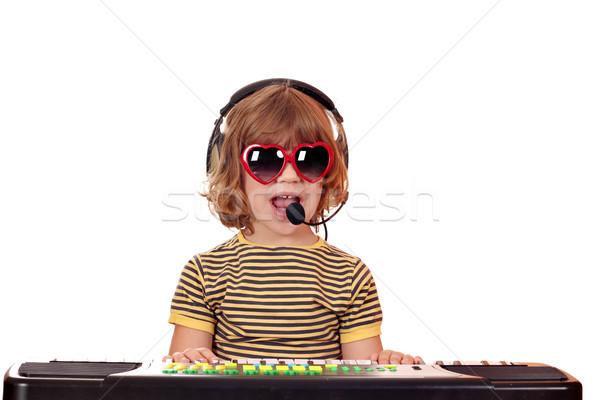 Mutlu küçük kız oynamak müzik şarkı söylemek çocuk Stok fotoğraf © goce