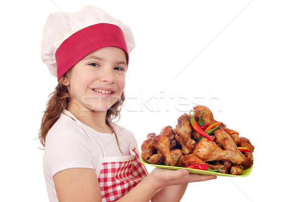 happy little girl cook with chicken drumstick Stock photo © goce