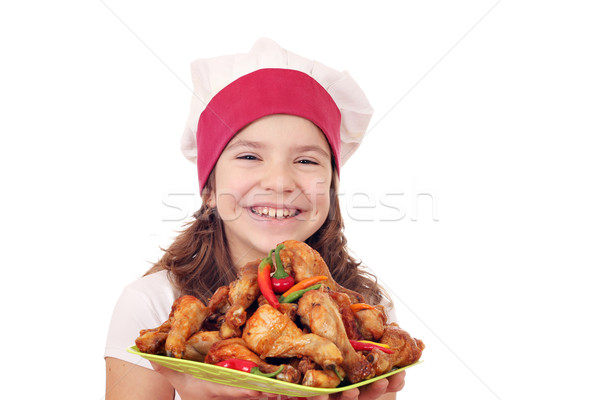 happy little girl cook with chicken drumsticks Stock photo © goce