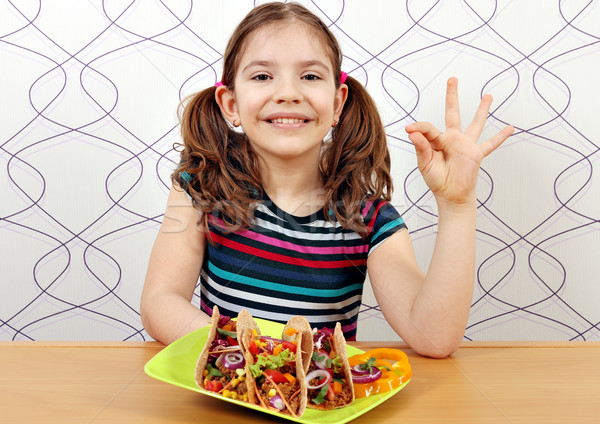 happy little girl with tacos and ok hand sign Stock photo © goce
