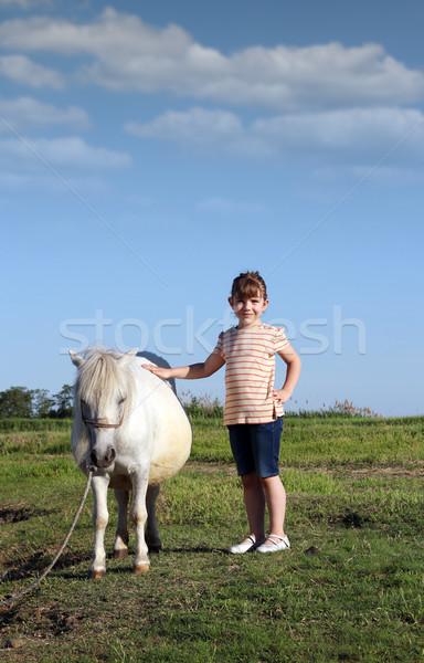 Boldog kislány póni ló lány mező Stock fotó © goce